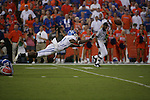 "junior cornerback Randall Burden reaches for an incomplete pass during the first half of UK's game against Florida at the ""Swamp"" in Gainesville, Florida on Saturday, Sept. 25, 2010. Photo by Brandon Goodwin 