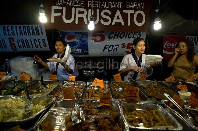 Stalls sell a variety of fare at the weekly night market in Garapan, Saipan.  .Robert Gilhooly Photo