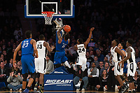 NEW YORK, NY - Thursday March 9, 2017: Marcus Foster (#0) of Creighton goes up for a lay-up against Kyron Cartwright (#24) of Providence as the two schools square off in the Quarterfinals of the Big East Tournament at Madison Square Garden.