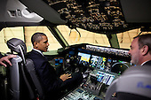 United States President Barack Obama sits in the cockpit of a 787 Dreamliner during his tour of the Boeing Plant production facility in Everett, Washington, February 17, 2012. .Mandatory Credit: Pete Souza - White House via CNP