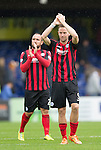Ross County v St Johnstone...10.08.14  SPFL<br /> Steven MacLean and Lee Croft celebrate at full time...It's the first away win for saints in the top flight on the opening day of the season since 1974<br /> Picture by Graeme Hart.<br /> Copyright Perthshire Picture Agency<br /> Tel: 01738 623350  Mobile: 07990 594431