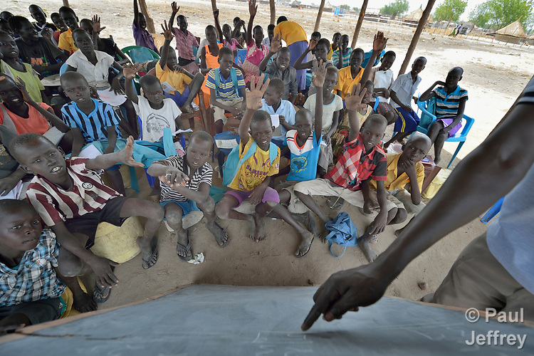 A primary school class in Panyagor, a town in South Sudan's Jonglei State, meets in a temporary shelter. <br /> <br /> The Lutheran World Federation, a member of the ACT Alliance, is helping families in the troubled region, which is torn by both war and drought, to educate their children, with a special focus on insuring that girls enter and remain in school. LWF is building new permanent classrooms as schools expand their services.