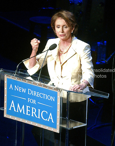 """Washington, D.C. - January 4, 2007 -- U.S. House Speaker Nancy Pelosi shakes her fist during her remarks at the """"Swearing-in Celebration Concert"""" at the National Building Museum in Washington, D.C. on Thursday, January 4, 2007..Credit: Ron Sachs / CNP"""