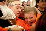 Sarah Thomas, left, and Stephanie Black, right, cry after Republicans pass a bill to eliminate collective bargaining at the State Capitol in Madison, Wisconsin, February 25, 2011.