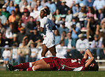 Texas A&M's Ashlee Pistorius (24) lies on the field as the game continues after being injured by knocking heads with a UNC player on Saturday, November 25th, 2006 at Fetzer Field in Chapel Hill, North Carolina. The University of North Carolina Tarheels defeated the Texas A&M Aggies 3-2 in an NCAA Division I Women's Soccer Championship quarterfinal game.
