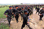 Rebels of the Revolutionary Armed Forces of Colombia, FARC,  walk just outside of San Vicente del Caguan in the former FARC controlled zone of Colombia. The FARC are Colombia's oldest and largest rebel group numbering over 18,000 rebels. The U.S. government estimates that the rebels make 300 million dollars a year off of the drug trade. (Photo/Scott Dalton)