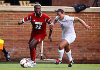 WINSTON-SALEM, NORTH CAROLINA - September 01, 2013:<br />  Christine Exeter (22) of Louisville University moves away from Jackie McSally (6) of Wake Forest University during a match at the Wake Forest Invitational tournament at Wake Forest University on September 01. The match was abandoned early in the second half due to severe weather with Wake leading 1-0.