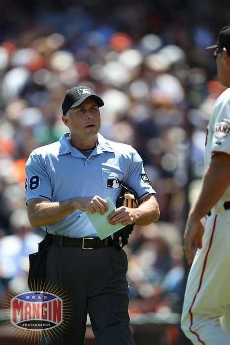 SAN FRANCISCO, CA - AUGUST 2:  Home plate umpire Dan Iassogna talks with manager Bruce Bochy #15 of the San Francisco Giants during the game against the New York Mets at AT&T Park on Thursday, August 2, 2012 in San Francisco, California. Photo by Brad Mangin