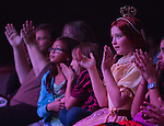 Dressed as Queen Elizabeth, Katie Mosher, 10, center, applauds performers in the School of Music's Hallowpalooza Concert at the Memorial Auditorium on Oct. 29, 2014. Photo by Lauren Pond