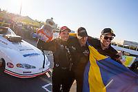 Feb 8, 2015; Pomona, CA, USA; NHRA top alcohol funny car driver Jonnie Lindberg celebrates with his crew after winning the Winternationals at Auto Club Raceway at Pomona. Mandatory Credit: Mark J. Rebilas-USA TODAY Sports