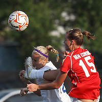 Boston Breakers midfielder Leslie Osborne (12) heads the ball despite high kick (no whistle) by Western New York midfielder Emily Van Egmond (15). In a Women's Premier Soccer League Elite (WPSL) match, the Boston Breakers defeated Western New York Flash, 3-2, at Dilboy Stadium on May 26, 2012.