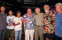 """HONOLULU, Turtle Bay Resort, North Shore, Oahu. - (Thursday, January 3, 2013) Kohl Christensen (HAW), Garrett McNamara (HAW), Reno Abellira (HAW), Greg Noll (HAW), Peter Cole (USA) Kimo Hollinger (HAW) and Randy Rarick (HAW).   Greg Noll (USA) was the guest  speaker of Talk Story at Surfer The Bar tonight, Noll, nicknamed """"Da Bull"""" by Phil Edwards in reference to his physique and way of """"charging"""" down the face of a wave is an American pioneer of big wave surfing and is also acknowledged as a prominent longboard shaper. Noll was a member of a US lifeguard team that introduced Malibu boards to Australia around the time of the Melbourne Olympic Games. Noll became known for his exploits in large Hawaiian surf on the North Shore of Oahu. He first gained a reputation in November 1957 after surfing Waimea Bay in 25-30 ft surf when it had previously been thought impossible even to the local Hawaiians. He is perhaps best known for being the first surfer to ride a wave breaking on the outside reef at the so-called Banzai Pipeline in November 1964...It was later at Makaha, in December 1969, that he rode what many at the time believed to be the largest wave ever surfed. After that wave and the ensuing wipeout during the course of that spectacular ride down the face of a massive dark wall of water, his surfing tapered off and he closed his Hermosa Beach shop in the early 1970s. He and other surfers such as Pat Curren, Mike Stang, Buzzy Trent, George Downing, Mickey Munoz, Wally Froyseth, Fred Van Dyke and Peter Cole are viewed as the most daring surfers of their generation...Noll is readily identified in film footage while surfing by his now iconic black and white horizontally striped """"jailhouse"""" boardshorts and was interviewed by host Jodi Wilmott (AUS). . Photo: joliphotos.com"""