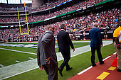 Houston, Texas<br /> October 2, 2011<br /> <br /> Team owner Bob McNair (blue jacket) with son Cary McNair (black jacket) and general manager and first as executive vice president, Rick Smith (grey jacket) leave the field for their sky-box as the game is played.<br /> <br /> The Houston Texans defeated the Pittsburgh Steelers at the Reliant Stadium 17 to 10.