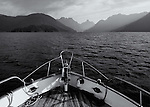 The entrance to Jervis Inlet is seen from the bow of a small vessel on this bright cloudy day along the coast of British Columbia.
