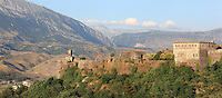 Kalaja e Gjirokastres or Gjirokastra Castle, built before the 12th century and expanded by Ali Pasha of Tepelene after 1812, Gjirokastra, Albania. The castle dominates the town and overlooks the strategically important route along the river valley. The government of King Zog expanded the castle prison in 1932. Today it has 5 towers and houses, the new Gjirokastra Museum, a clock tower, a church, a cistern and the stage of the National Folk Festival. Gjirokastra was settled by the Greek Chaonians, the Romans and Byzantines before becoming an Ottoman city in 1417. Its old town was listed as a UNESCO World Heritage Site in 2005. Picture by Manuel Cohen