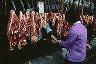 October 1984. Si Shuan Province, a meat market in the village of Pixian which is 30km west of Cheng Du.