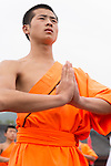 Shaolin Kung Fu student with his hands folded at the opening ceremony of Zhengzhou International Wushu Fetival in DengFeng, Henan, China 2014