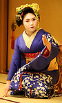 "Geisha, or geiko as they are called in Kyoto, are traditionally entertainers whose skills include performing various Japanese arts such as classical music and dance. Apprentice geisha are called maiko literally ""dance child"". It is the maiko with her white make-up and elaborate kimono and hairstyle, that has become the stereotype of a geisha to Westerners."