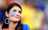 A Greece fan looks on before kick off
