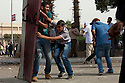 Egyptian youth activists use a piece of sheet metal as a shield as they battle Egyptian security forces during May 4, 2012 demonstrations against the ruling Supreme Council of the Armed Forces (SCAF) near the Defense ministry building in the Abbasiya district of Cairo. Close to 300 people were injured in the clashes, one killed, and an estimated 300 people arrested by the military.