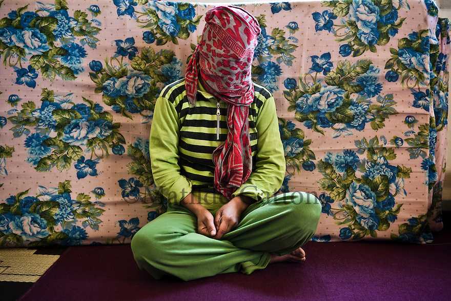 Lebanon - Jdeideh - Karam, 28-year-old, comes from Homs. Her house was in Bab Amr, right in front of the tanks of the Syrian Army. After being moved by the rebels to another house at the centre of the neighbourhood, four months ago she decided to leave, together with her, family. During the clandestine trip to Lebanon she was helped by the Free Syrian Army. ?They showed us the way, they kept my little baby... If it weren't for them, we wouldn't be here today?.