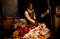 A splash of color amid the deep darkness of the backstreets of Varanasi. (Photo by Matt Considine - Images of Asia Collection)
