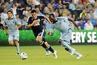 C.J Sapong (17) Sporting KC forward in a foot race with Vancouver Whitecaps defender (2) Michael Boxall... Sporting KC defeated Vancouver Whitecaps 2-1 at LIVESTRONG Sporting Park, Kansas City, Kansas.