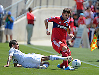 LA Galaxy defender Sean Franklin (5) slide tackles the ball away from Chicago defender Gonzalo Segares (13).  The LA Galaxy defeated the Chicago Fire 2-0 at Toyota Park in Bridgeview, IL on July 8, 2012.