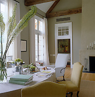 Tones of grey and ochre create a restful colour scheme in the kitchen/dining area; the perfect setting for relaxed country entertaining