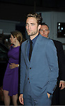 "Robert Pattinson attends the New York Premiere of ""Cosmopolis"" on August 13, 2012 at MoMA in New York City. The premiere was presented by Gucci and The Peggy Siegal Company. .The stars of the movie are Robert Pattinson, Paul Giamatti, Sarah Gadon, Kevin  Durand and Emily Hampshire."