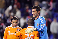 Houston Dynamo goalkeeper Tally Hall (1) celebrates with Corey Ashe (26) after the game. The New York Red Bulls  and the Houston Dynamo played to a 1-1 tie during a Major League Soccer (MLS) match at Red Bull Arena in Harrison, NJ, on April 02, 2011.