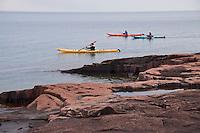 Sea kayakers on Lake Superior in Grand Marais Minnesota.