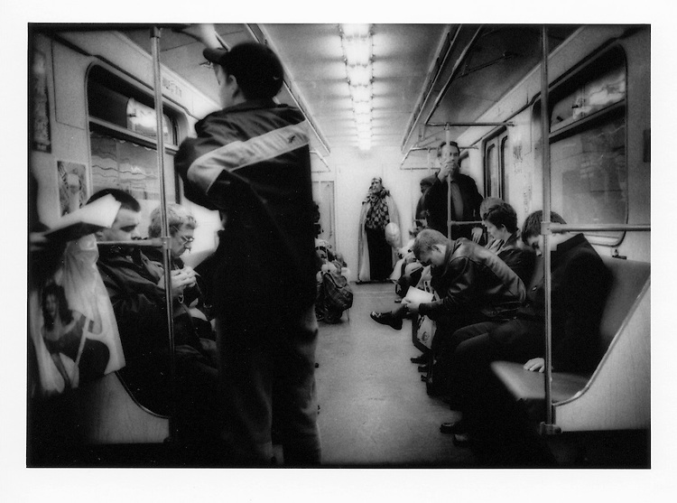 Man at the end of the carriage, Moscow Subway, Russia.