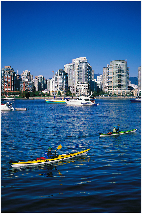 Two kayaks and the condominium towers of False Creek, Vancouver, BC.
