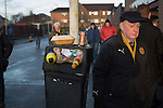 Motherwell 3 Dundee 1, 12/12/2015. Fir Park, Scottish Premiership. A home team supporter walking past a litter bin at Fir Park, home to Motherwell Football Club, before they played Dundee in a Scottish Premiership fixture. Formed in 1886, the  home side has played at Fir Park since 1895. Motherwell won the match by three goals to one, watched by a crowd of 3512 spectators. Photo by Colin McPherson.