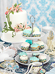 Still life photo of a luxurious tea party with sweets, jewellery and accessories