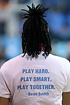 """19 February 2015: North Carolina's Hillary Fuller wears a t-shirt during the pregame with a quote from recently deceased UNC coaching legend Dean Smith reading, """"Play Hard. Play Smart. Play Together."""" The University of North Carolina Tar Heels hosted the Wake Forest University Demon Deacons at Carmichael Arena in Chapel Hill, North Carolina in a 2014-15 NCAA Division I Women's Basketball game."""