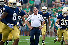 Aug. 31, 2013; Head coach Brian Kelly watches his team run onto the field before the game against Temple. Photo by Barbara Johnston/University of Notre Dame