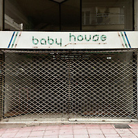 A closed down shop, on Frontzou Street, that used to sell baby clothes.
