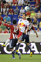 Juan Pablo Angel (9) of the New York Red Bulls heads the ball just over the goal as Mariano Trujillo (8) defends. The New York Red Bulls defeated Chivas USA 1-0 during a Major League Soccer (MLS) match at Red Bull Arena in Harrison, NJ, on June 5, 2010.