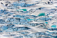 Aerial view of crevasses and aqua water pools in the Miles glacier, Chugach mountains, southcentral, Alaska.