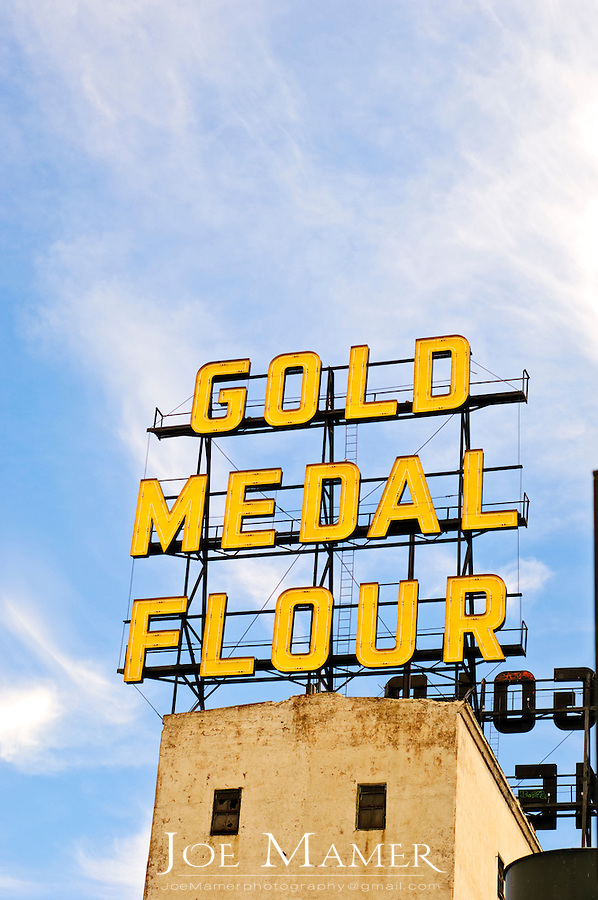 Gold Medal Flour sign atop the Washburn A mill in Minneapolis, Minnesota, now the site of the Mill City Museum. Opened in 1880, the Washburn A Mill, designed by Austrian engineer William de la Barre, was the largest flour mill in the world, a designation it retained until the Pillsbury A Mill opened across the river in 1881. Washburn later teamed up with John Crosby to form the Washburn-Crosby Company, which later became General Mills.