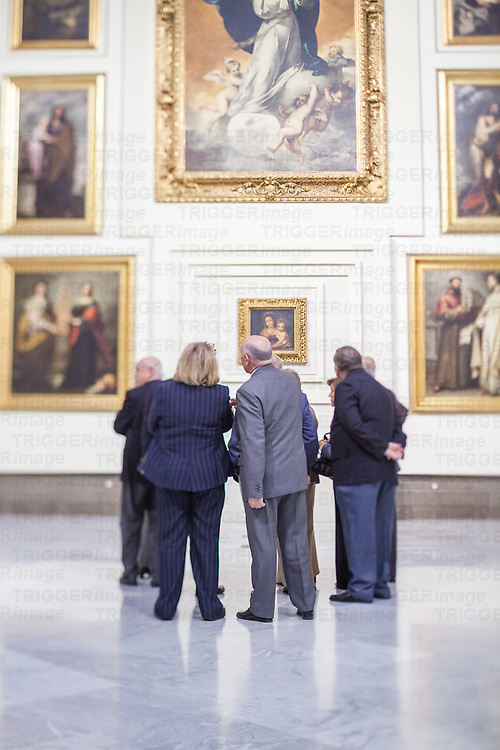 Visitors in the room V (Sevillian Baroque), Museum of Fine Arts, Seville, Spain. Tilted lens used for shallower depth of field.