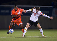 Patrick Mullins (15) of Maryland fights for the ball with Phanuel Kavita (18) of Clemson during the ACC tournament semifinals at the Maryland SoccerPlex in Boyds, MD.  Maryland defeated Clemson, 1-0, in overtime.