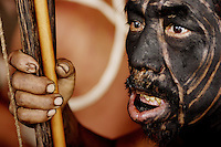 Viriunaveteri, Venezuela. A Yanomami shaman watching a tribal dance. In his mouth he has tobacco. He also took the hallucinogenic drug Joppo. Yoppo..The village of Viriunaveteri consists of 15 huts around a muddy square. It's situated in the Venezuelan Amazone several days by boat from the nearest town. This community on the banks of the Casiquiare is one of the few Yanomami villages that actually has some contact with the outside world. Most other tribes live deeper in the jungle.