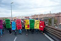 """Roma, 27 Ottobre 2012: .No Monti Day, manifestazione nazionale contro le politiche del  governo Monti..Book-Block sulla tangenziale..""""No Monti Day"""" protest in Rome against the austerity cuts of the Italian government."""