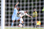 28 August 2015: North Carolina's Jordan McCrary (9) and FIU's Juan Benedetty (18). The University of North Carolina Tar Heels hosted the Florida International University Panthers at Fetzer Field in Chapel Hill, NC in a 2015 NCAA Division I Men's Soccer match. North Carolina won the game 1-0
