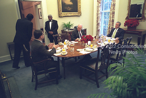 United States President George W. Bush dines with U.S. Vice President Dick Cheney and King Abdullah II of Jordan in the Oval Office Dining Room, Friday, February 1, 2002..Mandatory Credit: Eric Draper - White House via CNP.