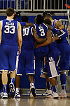 UK freshman forward Nerlens Noel is carried off the court by the team after fallling during the second half of the University of Kentucky vs. University of Florida men's basketball game at the O'Connell Center in Gainesville, Fl., on Tuesday, February 12, 2013. UK lost 69-52. Photo by Tessa Lighty | Staff