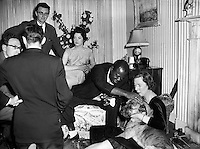 "Lady Goulding Hosts Party for Louis Armstrong. Enniskerry - 12pm-4pm..19/05/56..Louis Armstrong (August 4, 1901 - July 6, 1971), nicknamed Satchmo or Pops, was an American jazz trumpeter and singer from New Orleans, Louisiana..Coming to prominence in the 1920s as an ""inventive"" cornet and trumpet player, Armstrong was a foundational influence in jazz, shifting the music's focus from collective improvisation to solo performance. With his instantly recognizable deep and distinctive gravelly voice, resembling the sound of a trumpet, Armstrong was also an influential singer, demonstrating great dexterity as an improviser, bending the lyrics and melody of a song for expressive purposes. He was also greatly skilled at scat singing, vocalizing using sounds and syllables instead of actual lyrics..Renowned for his charismatic stage presence and voice almost as much as for his trumpet-playing, Armstrong's influence extends well beyond jazz music, and by the end of his career in the 1960s, he was widely regarded as a profound influence on popular music in general. Armstrong was one of the first truly popular African-American entertainers to ""cross over,"" whose skin-color was secondary to his music in an America that was severely racially divided. It allowed him socially acceptable access to the upper echelons of American society that were highly restricted for a black man. While he rarely publicly politicized his race, often to the dismay of fellow African-Americans, he was privately a strong supporter of the Civil Rights movement in America."